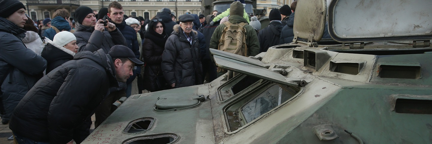 People look at the remains of an armoured personnel carrier that is part of an exhibition of weapons, drones, documents and other materials the Ukrainian government claims it recovered in eastern Ukraine and prove direct Russian involvement in the fighting between Ukrainian troops and pro-Russian separatists on February 22, 2015 in Kiev, Ukraine. Russia has denied sending heavy weaponry to the separatists, admitting only that Russian volunteers are participating in the fighting.