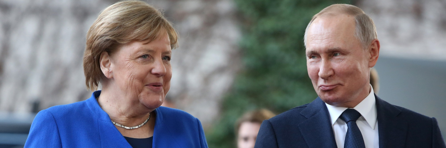 A photograph of German Chancellor Angela Merkel (CDU, L) greets Russian President Vladimir Putin as he arrives for an international summit on securing peace in Libya at the German federal Chancellery on January 19, 2020 in Berlin, Germany. Leaders of nations and organizations linked to the current conflict are meeting to discuss measures towards reaching a consensus between the warring sides and ending hostilities.