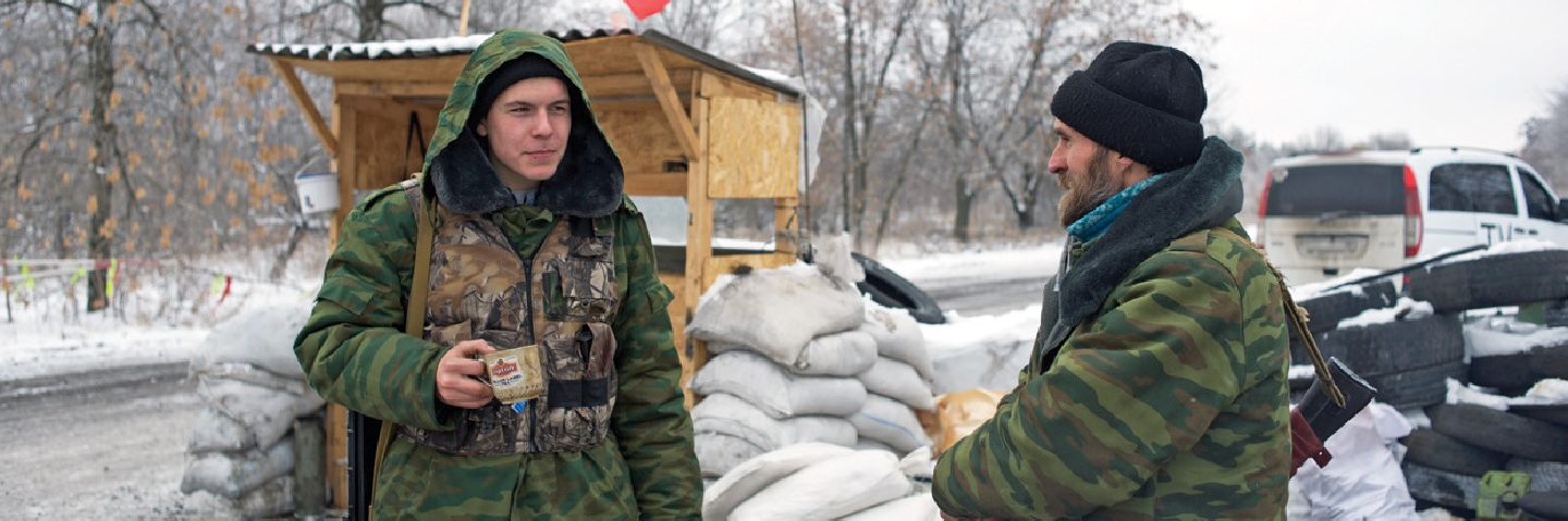 Members of the pro-Russian 1st Cossack Regiment guard a checkpoint.