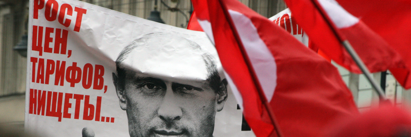 "Opposition activists and supporters take part an anti-Putin protest the second Russia's city of Saint Petersburg, on September 15, 2012. The poster depicts Russian president Vladimir Putin and reads: ""What have you elected is the rising prices and poverty!"""