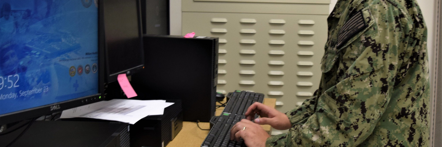 soldier at work on computer