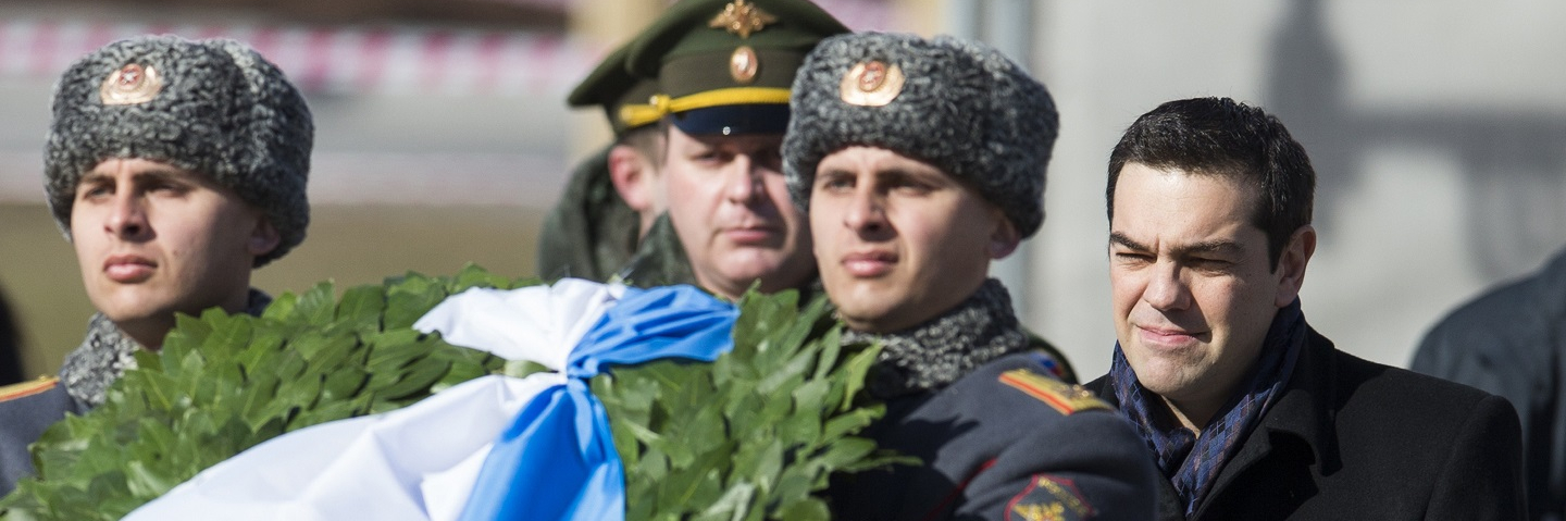 Russian soldier and Greek Prime Minister Alexis Tsipras take part in a wreath-laying ceremony at the Tomb of the Unknown Soldier by the Kremlin Wall in Moscow.