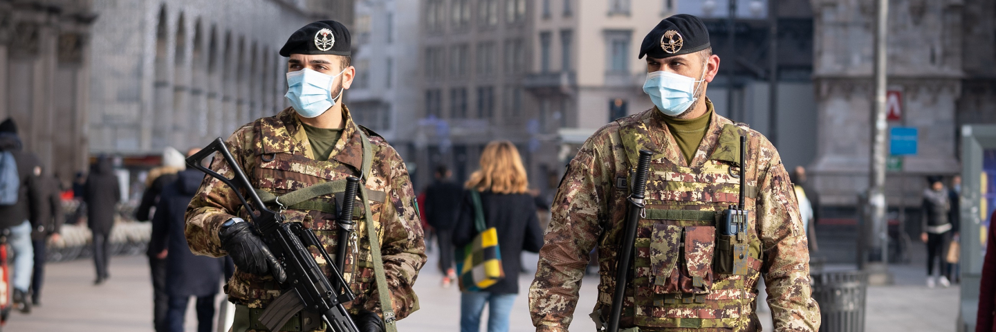 Two soldiers wearing face masks patrol Duomo Square in Milan, Italy on December 14, 2020. Since December 13, no region in Italy is in total lockdown anymore (red zone), however, given the high number of people seen on the streets in the very first days, the government is already thinking of re-imposing strict measures for the Christmas holidays in order to avoid a third wave of coronavirus (Covid-19) pandemic.