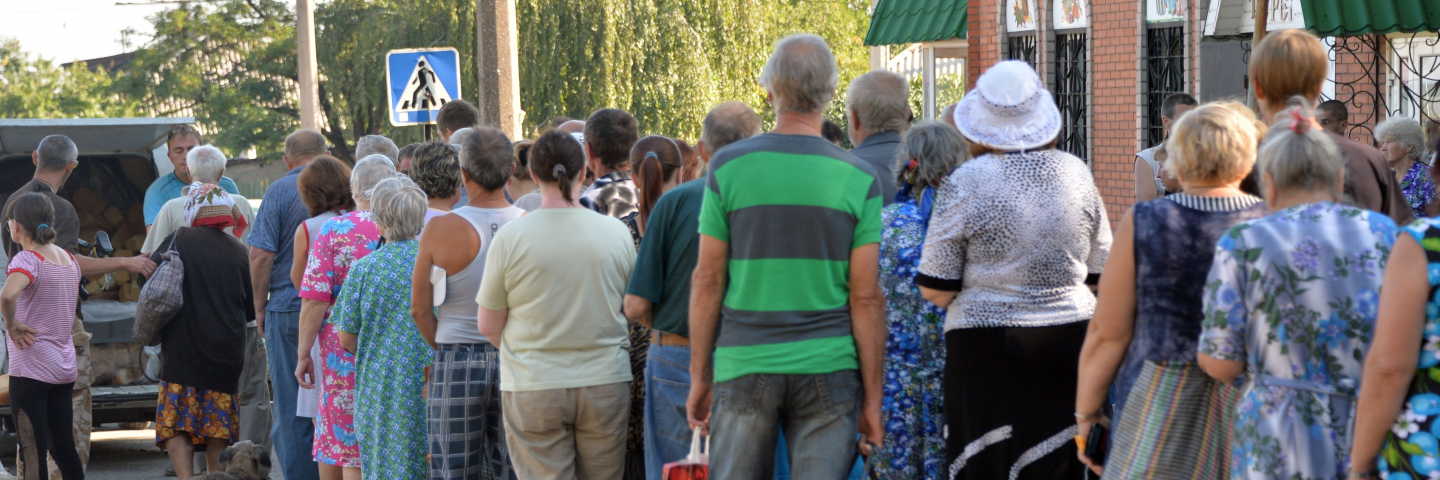 Residents of the eastern Ukrainian city of Lysychansk queue to receive bread distributed as part of humanitarian aid on July 27, 2014. Ukrainian troops have retaken the strategically-important city of Lysychansk in eastern Ukraine, as they press on with their offensive to stamp out a pro-Russian rebellion.