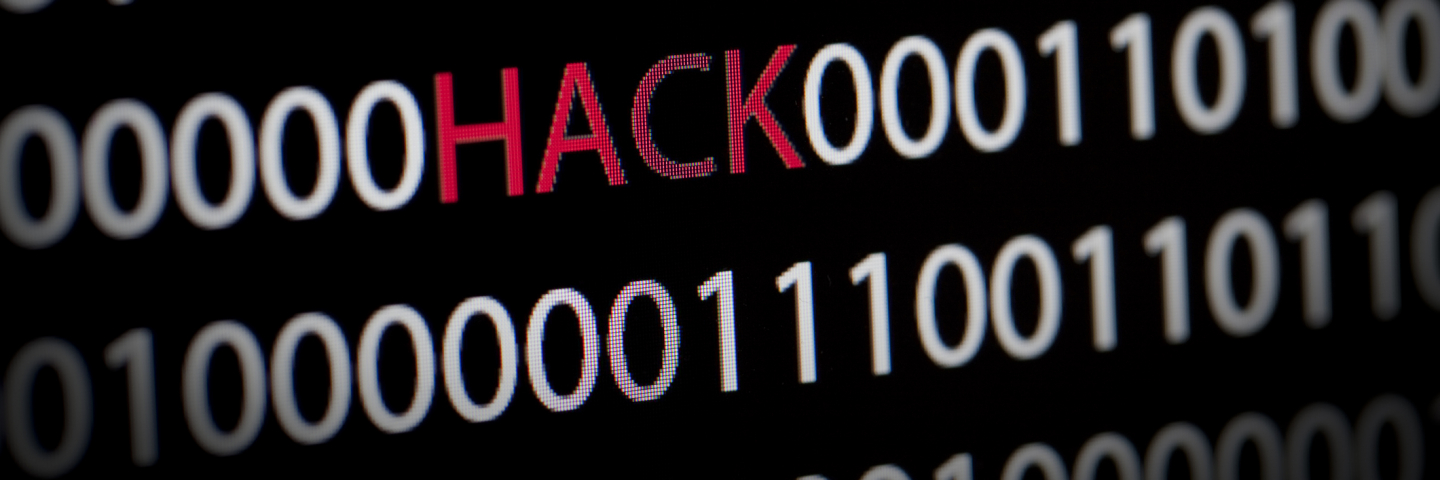 Hacking graphic with zeros and ones with the work HACK in the center.