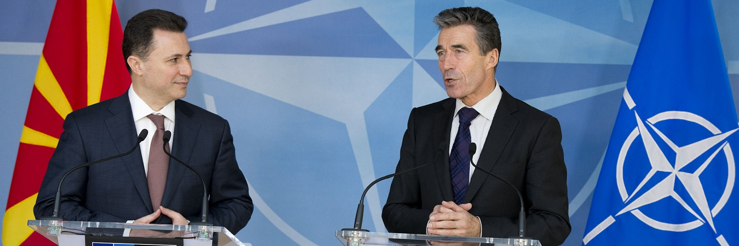 NATO Secretary General, Mr. Anders Fogh Rasmussen and the Prime Minister of the former Yugoslav Republic of Macedonia, Mr. Nikola Gruevski, standing at podiums with flags behind them.