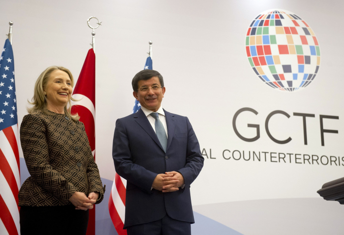 Turkish Foreign Minister Ahmet Davutoglu and US Secretary of State Hillary Clinton pose before a press conference at the Global Counterterrorism Forum in Istanbul on June 7, 2012