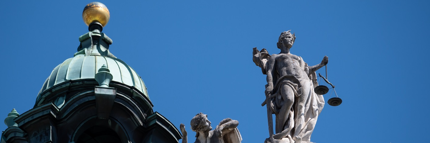 The statue of Justice sits atop the Palace of Justice in Bavaria, Munich.