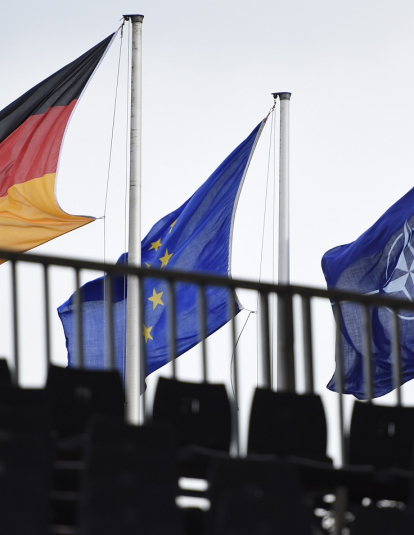 The Flags of Germany, the European Union and the NATO (North Atlantic Treaty Organization) hang during a military exercise on October 10, 2017 near Munster, Germany.