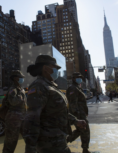 NEW YORK, NY - APRIL 06: U.S Army personnel wearing masks cross 34th street on April 6, 2020 in New York City. The COVID-19 death toll in the U.S. is approaching 10,000.