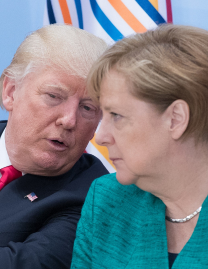 A photograph of German Chancellor Angela Merkel (R) and US President Donald Trump attend a panel discussion titled 'Launch Event Women's Entrepreneur Finance Initiative' on the second day of the G20 summit on July 8, 2017 in Hamburg, Germany.