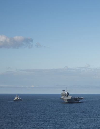"A photograph of the Royal Navy frigates HMS Iron Duke (F234), left, and HMS Westminster (F237), the Royal Norwegian Navy frigate KNM Helge Ingstad (F313), the Royal Navy aircraft carrier HMS Queen Elizabeth (R08), the U.S. Navy guided-missile destroyer USS Donald Cook (DDG-75), the aircraft carrier USS George H.W. Bush (CVN-77), and the guided-missile cruiser USS Philippine Sea (CG-58) underway in formation during exercise ""Saxon Warrior 2017"", 8 August 2017."