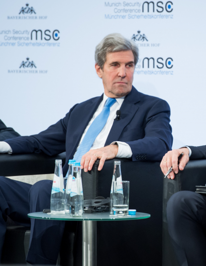 A photograph of John F. Kerry and Aleksey Pushkov at the Munich Security Conference in 2018.
