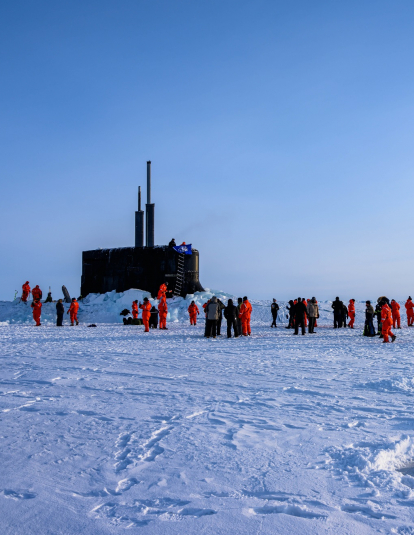 The crew of the Seawolf-class fast-attack submarine, USS Connecticut (SSN 22), enjoys ice liberty after surfacing in the Arctic Circle during Ice Exercise (ICEX) 2020. ICEX 2020 is a biennial submarine exercise which promotes interoperability between allies and partners to maintain operational readiness and regional stability, while improving capabilities to operate in the Arctic environment.