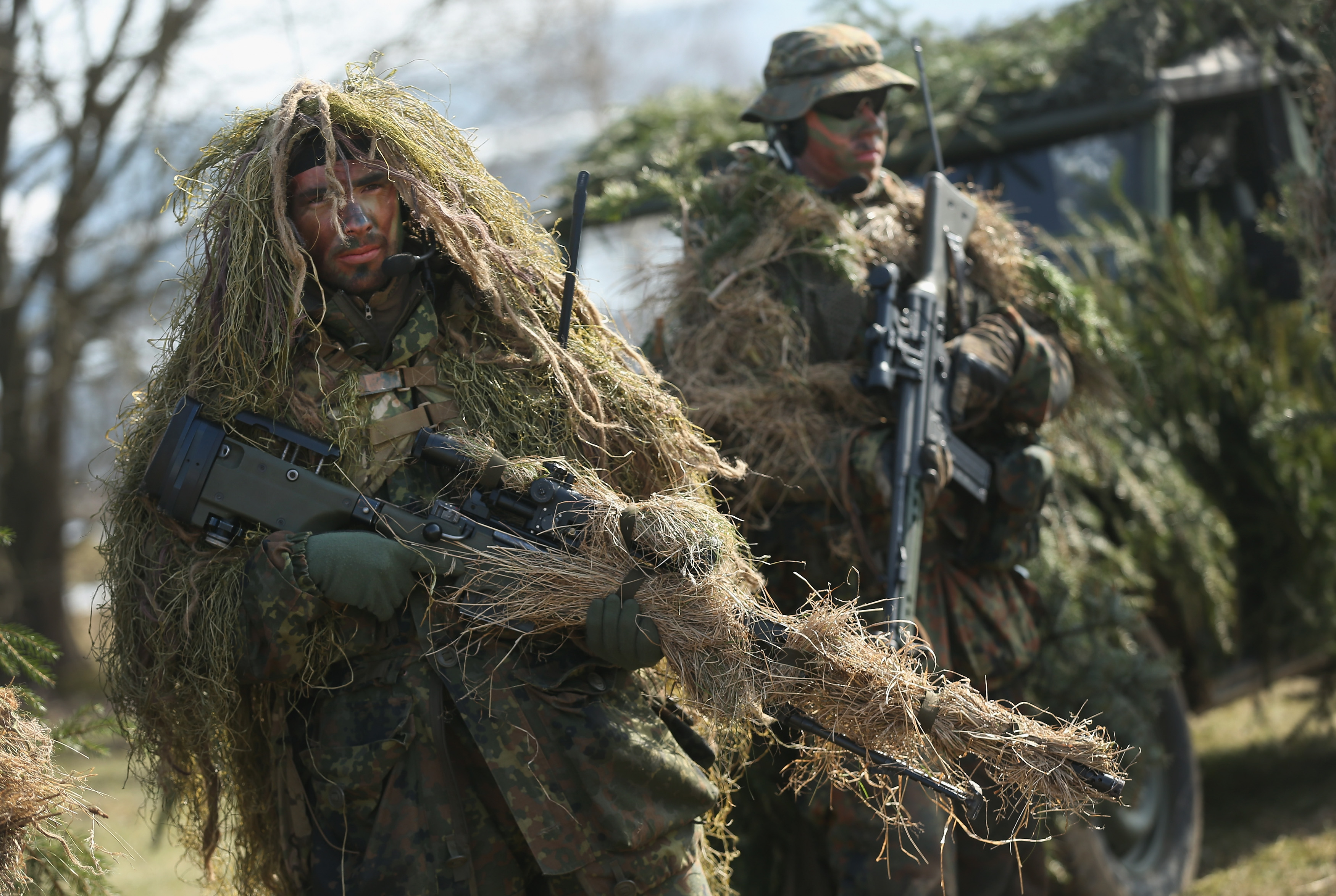 MARIENBERG, GERMANY - MARCH 10: Members of the German Bundeswehr's 371st Armoured Infantry Battalion (Panzergredanadierbataillon 371) stand in camouflage with sniper rifles during a media event at the battalion's base on March 10, 2015 in Marienberg, Germany.