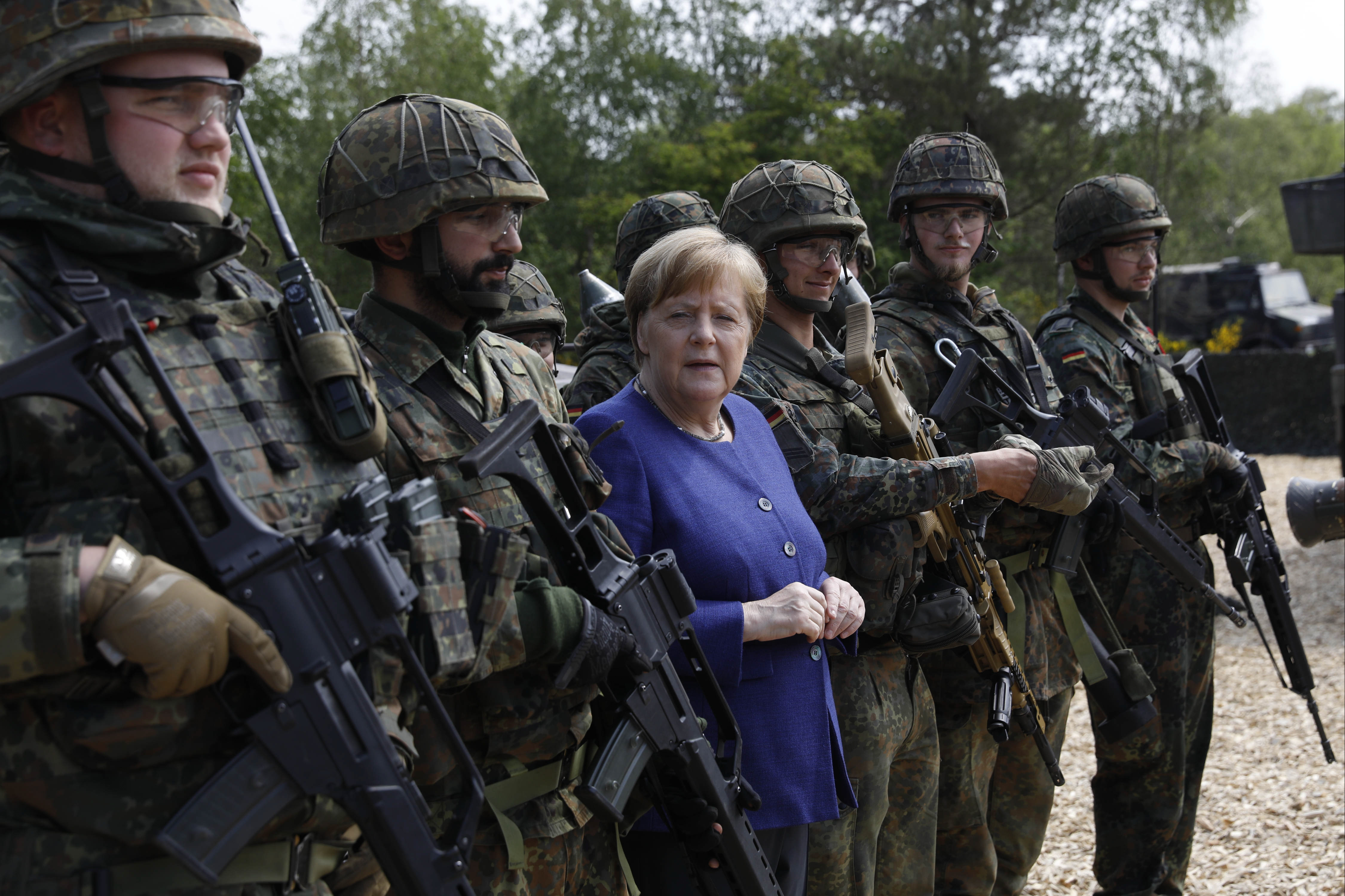 MUNSTER, GERMANY - MAY 20: German Chancellor Angela Merkel poses with members of the Bundeswehr Panzerlehrbrigade 9 (9th Armoured Demonstration Brigade) during a presentation of capabilities by the unit on May 20, 2019 in Munster, Germany.
