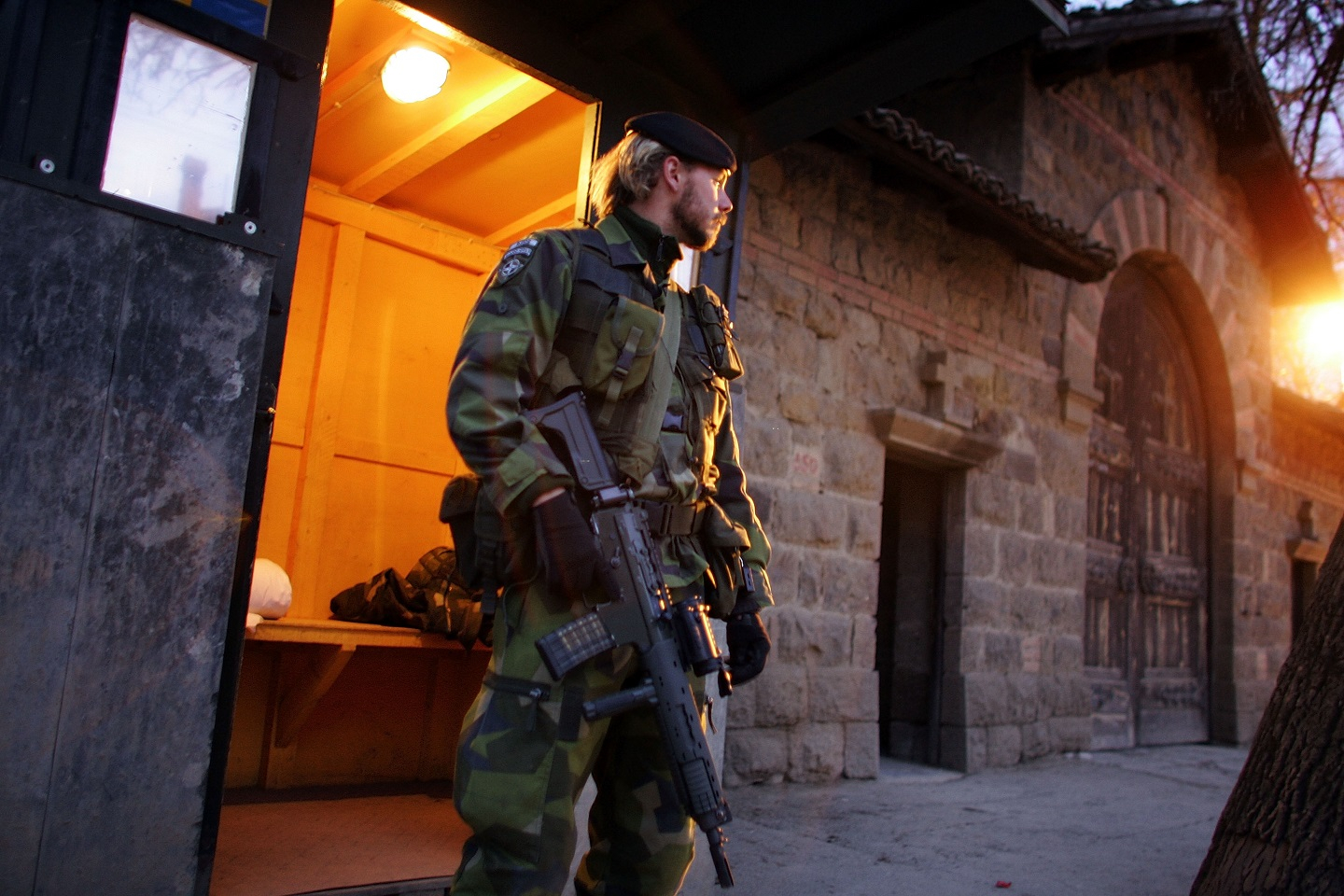 A photograph of a Swedish Kosovo Force (KFOR) soldier.