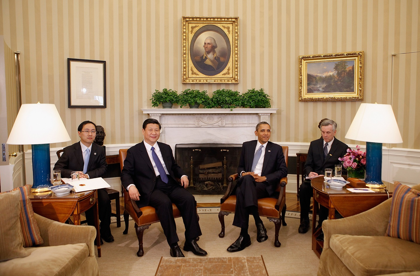WASHINGTON, DC - FEBRUARY 14: U.S. President Barack Obama (2nd R) and Chinese Vice President Xi Jinping (2nd L) pose for photographs before meeting in the Oval Office at the White House February 14, 2012 in Washington, DC. While in Washington, Vice President Xi will meet with Obama, Vice President Joe Biden and other senior Administration officials to discuss a broad range of bilateral, regional, and global issues.