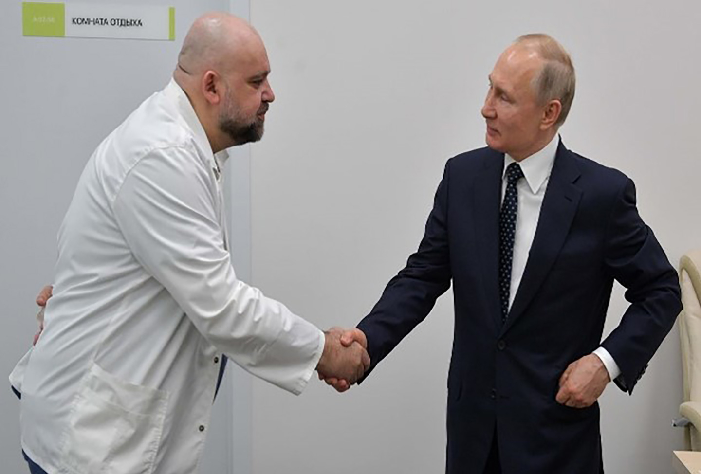 A photograph of Russian President Vladimir Putin shaking hands with the head of Moscow's new hospital treating coronavirus patients during his visit to Kommunarka hospital in Moscow, Russia.