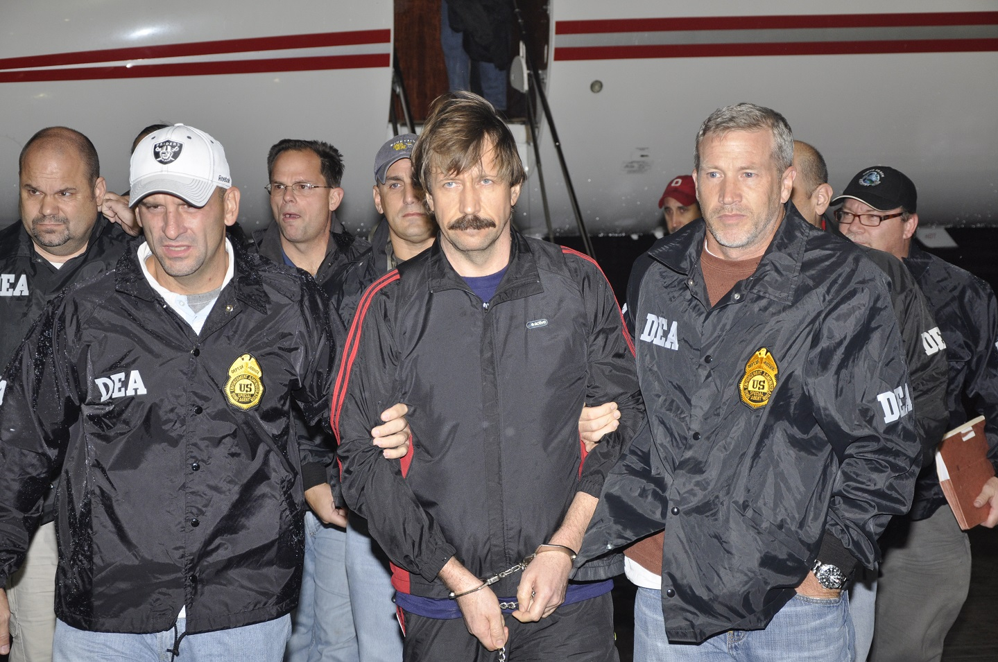 Former Soviet military officer and arms trafficking suspect Viktor Bout deplanes after arriving at Westchester County Airport November 16, 2010 in White Plains, New York.