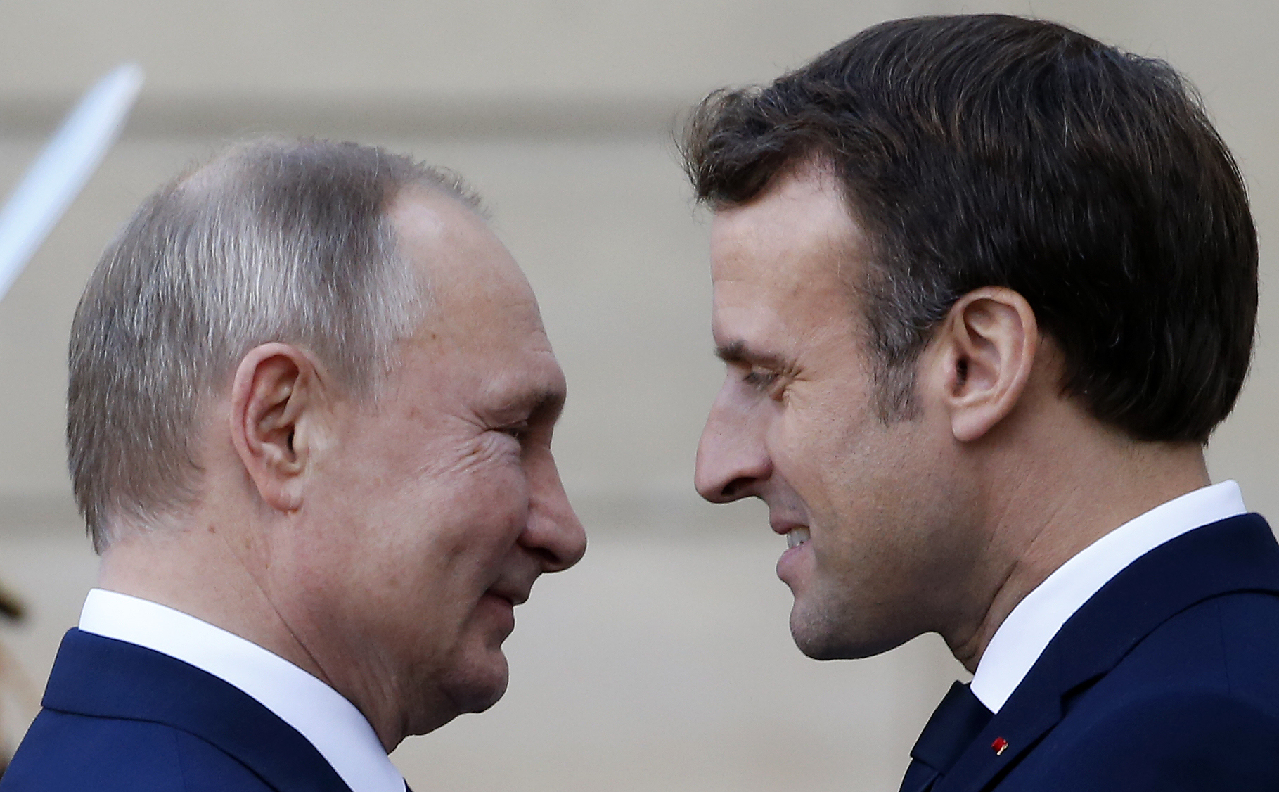 A photograph of French President Emmanuel Macron welcoming Russian President, Vladimir Putin as he arrives at the Elysee Presidential Palace to attend a summit on Ukraine on December 09, 2019 in Paris, France.
