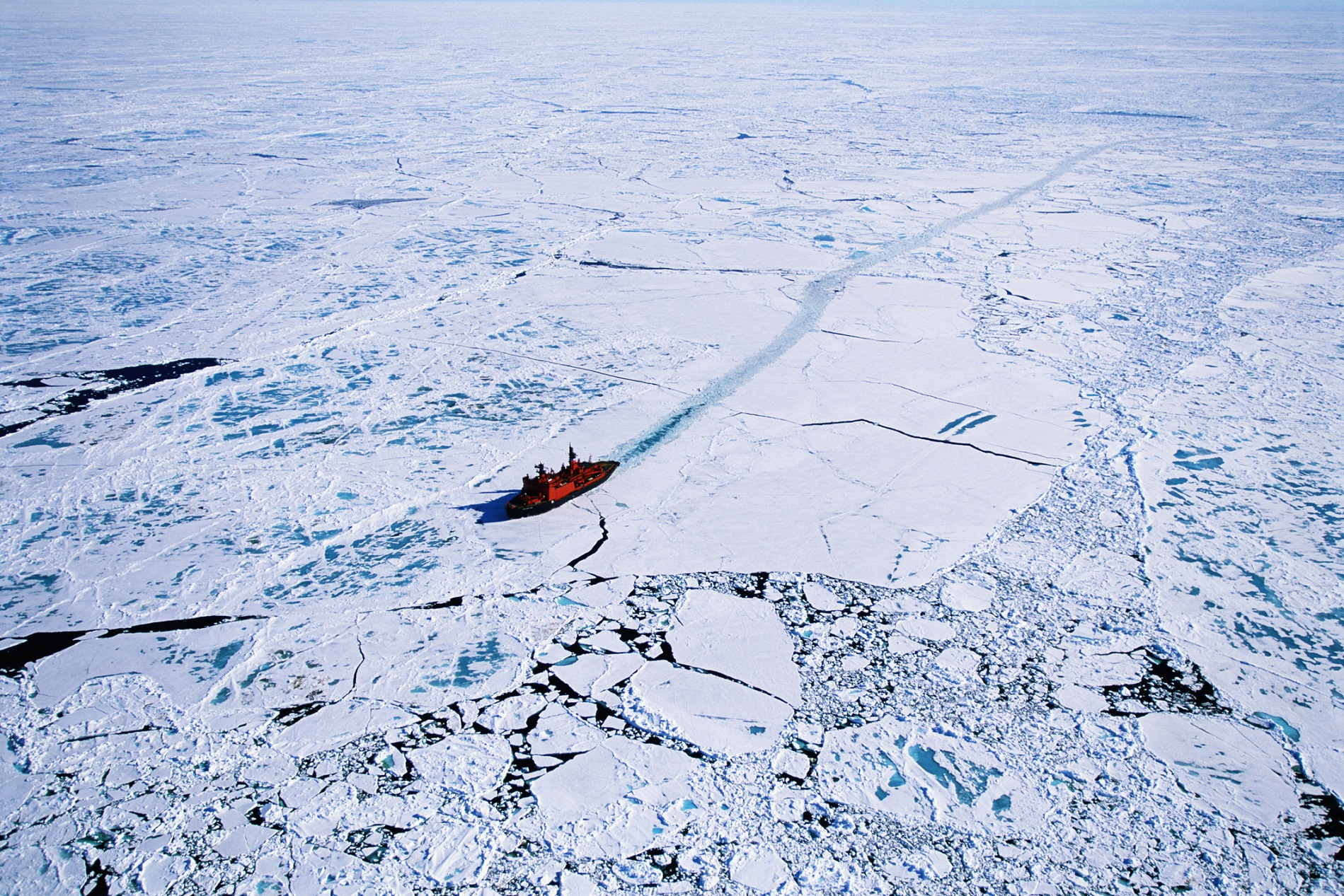 Russian nuclear icebreaker clearing a path to North Pole, aerial view.