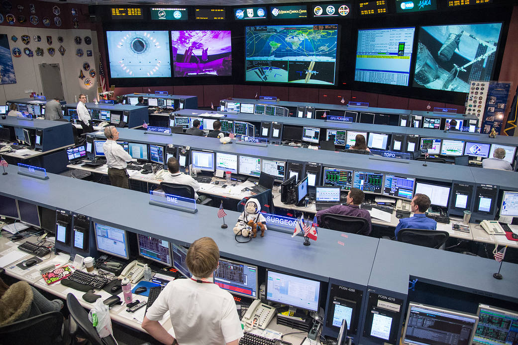 JSC2014-E-005996 (12 Jan. 2014) --- As the Canadarm2 berthed the Orbital Sciences Corp. Cygnus commercial cargo craft to the Harmony node of the International Space Station on Jan. 12, 2014, flight controllers supported the orbital work in the space station flight control room (FCR-1) in JSC's Mission Control Center. Photo credit: NASA
