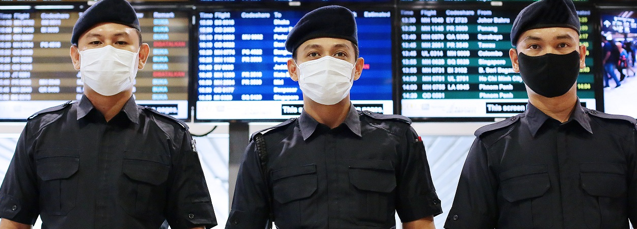 Malaysian Police at the Airport - in COVID-19 Masks