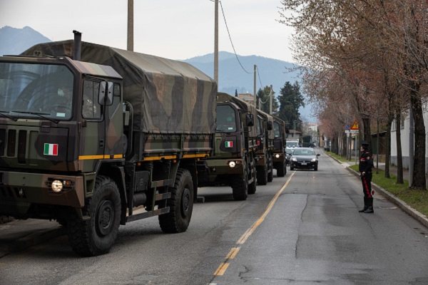 BERGAMO, ITALY - MARCH 26: A convoy of military vehicles arrives at the Monumental Cemetery on March 26, 2020 in Bergamo, near Milan, Italy. The Italian Army has been brought in to ferry coffins out of Bergamo, amongst Italy's most plagued towns, as its morgue and its crematorium struggle to cope with the surging coronavirus death toll. The Italian government continues to enforce the nationwide lockdown measures to control the spread of COVID-19.