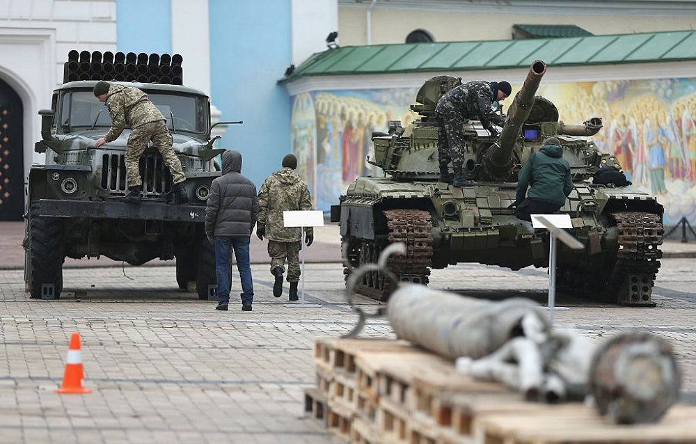 Security forces inspect a rocket launcher truck and a heavy tank that are part of an exhibition the Ukrainian government claims proves Russian direct involvement in the fighting between Ukrainian troops and pro-Russian separatists in eastern Ukraine prior to a visit to the exhibition by Ukrainian President Petro Poroshenko on February 22, 2015 in Kiev, Ukraine.
