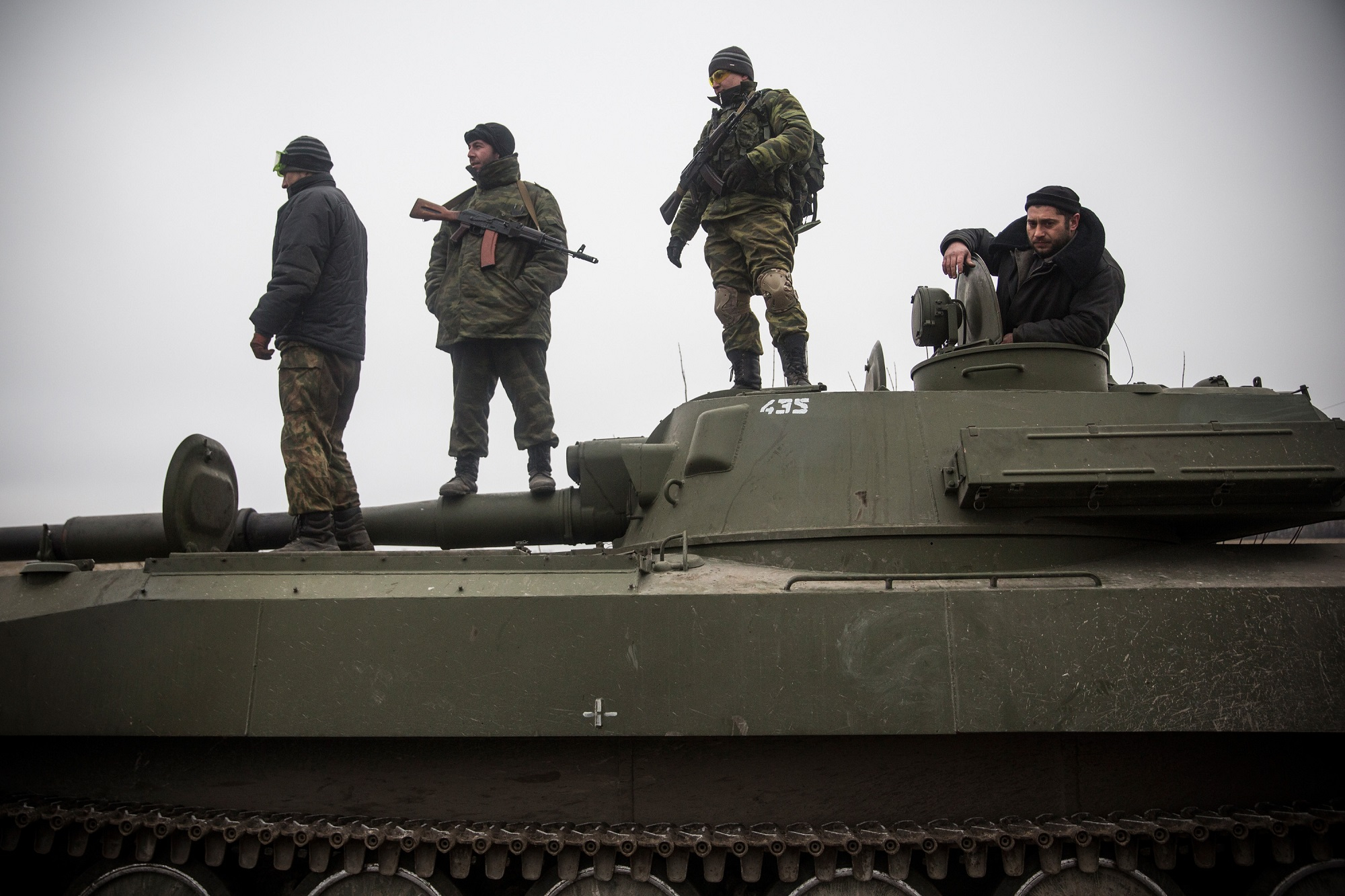 A photograph of Pro-Russian rebels allegedly move tanks and heavy weaponry away from the front line of fighting.