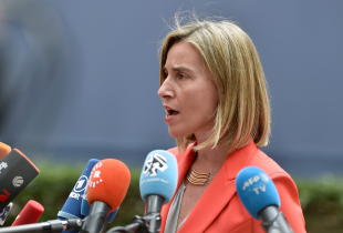 EU's High representative for foreign affairs and security policy Federica Mogherini talks to journalists as she arrives before an EU summit meeting on June 28, 2016 at the European Union headquarters in Brussels.