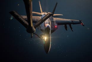 A U.S. Navy F/A-18E Super Hornet is refueled over the U.S. Central Command area of responsibility by a U.S. Air Force KC-135 Stratotanker, Sept. 22, 2020. The KC-135 delivers a global-reach aerial capability to support joint and coalition aircraft, and provide war-winning airpower throughout the USCENTCOM area of responsibility.
