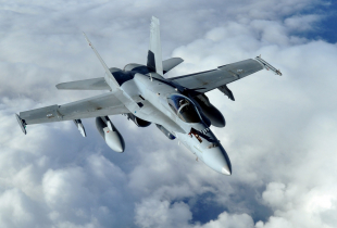 A Finnish air force F-18 Hornet aircraft flies during exercise Arctic Challenge 2013 over Norway Sept. 24, 2013.