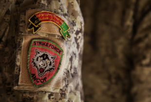 Close up photo of the arm patch of the Afghan National Civil Order Policemen (ANCOP).