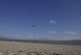 A RQ-7B Shadow unmanned aerial vehicle launches into the sky from the flight line at Combat Outpost Xio Haq in Afghanistan.