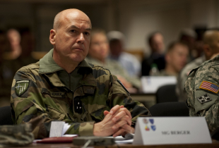French Maj Gen Jean Fred Berger, commander of NATO's Joint Warfare Centre in Stavanger Norway, listens to an exercise briefing at Exercise Unified Endeavor 12-2.