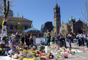 Visitors to Boston's Copley Square look at a memorial to victims of the April 2013 Boston Marathon bombing