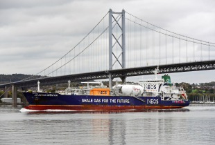Shale gas tanker J S Ineos Invention passes under the Forth Road Bridge en route from Grangemouth to the US port of Marcus