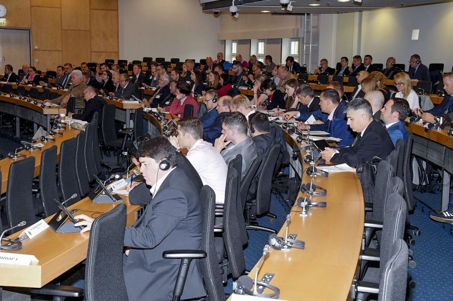 A photo of paticipants at an European Security Seminar.
