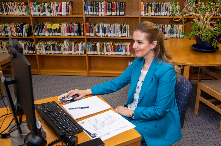 A photograph of Dr. Zeneli participating in the virtual seminar the COVID-19 Pandemic and the Role of Legislators.